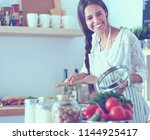 cooking woman in kitchen with... | Shutterstock . vector #1144925417