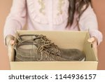 close up woman holding vintage... | Shutterstock . vector #1144936157