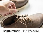 close up vintage leather shoes... | Shutterstock . vector #1144936361