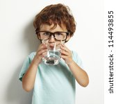Portrait Of Boy Drinking Glass...