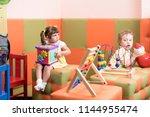 children girl and boy play... | Shutterstock . vector #1144955474