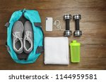 Sports bag and gym equipment on ...