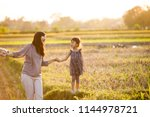 portrait of mom and kid... | Shutterstock . vector #1144978721