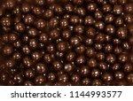 chocolate dragee. dark brown... | Shutterstock . vector #1144993577