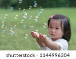 bubbles in front of the blur of ... | Shutterstock . vector #1144996304