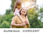 grandmother and granddaughter... | Shutterstock . vector #1145013347