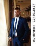 groom at wedding tuxedo smiling ... | Shutterstock . vector #1145018687