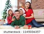 happy parents and children near ... | Shutterstock . vector #1145036357