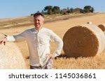 Farmer Working On Field Near...