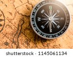 close up of old black compass... | Shutterstock . vector #1145061134