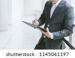 business concept  businessman... | Shutterstock . vector #1145061197