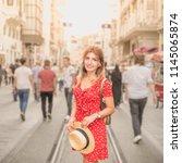 beautiful woman in red dress... | Shutterstock . vector #1145065874