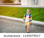 happy smiling kid in glasses is ... | Shutterstock . vector #1145079017