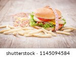 cheese hamburger with measuring ... | Shutterstock . vector #1145094584
