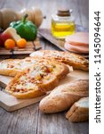 pizza baguette with ham in... | Shutterstock . vector #1145094644