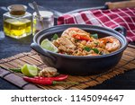 fried rice with spicy seafood ... | Shutterstock . vector #1145094647