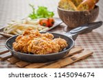 crispy fried chicken in kitchen ... | Shutterstock . vector #1145094674