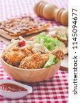 crispy fried chicken in kitchen ... | Shutterstock . vector #1145094677