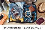 preparing travel suitcase high... | Shutterstock . vector #1145107427