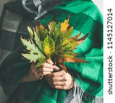 woman in warm woolen green... | Shutterstock . vector #1145127014