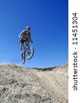 Man mountain biking on trail in outdoors - stock photo