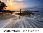 a woman standing on the rock ... | Shutterstock . vector #1145134214