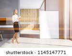 businesswoman with coffee in a... | Shutterstock . vector #1145147771