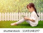 asian little chinese girl... | Shutterstock . vector #1145148197