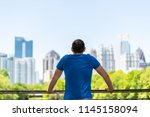 young man standing leaning on... | Shutterstock . vector #1145158094