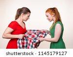 two beautiful young women... | Shutterstock . vector #1145179127