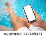 man at the pool holding phone... | Shutterstock . vector #1145256671