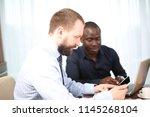 business meeting. top view of... | Shutterstock . vector #1145268104