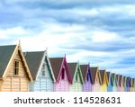 Row Of Coloured Beach Huts On ...