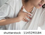 sick woman with indigestion... | Shutterstock . vector #1145290184