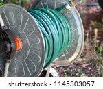 Green gardening hose for...