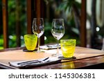 wine glasses and table setting... | Shutterstock . vector #1145306381