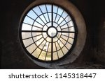 large round window in an old... | Shutterstock . vector #1145318447