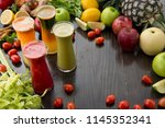 freshly squeezed fruits and... | Shutterstock . vector #1145352341