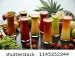 freshly squeezed fruits and... | Shutterstock . vector #1145352344