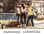 group of friends hangout at the ... | Shutterstock . vector #1145357261