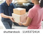 woman receiving parcel... | Shutterstock . vector #1145372414