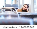 Stock photo sad tired woman in train or bus bored or unhappy passenger sitting in tram leaning against hand 1145375747