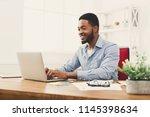 happy black businessman working ... | Shutterstock . vector #1145398634