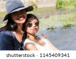 two asian girls  happy  posing... | Shutterstock . vector #1145409341