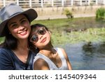 two asian girls  happy  posing... | Shutterstock . vector #1145409344