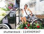 girl posing with genuine smile  ... | Shutterstock . vector #1145409347