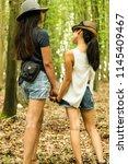two asian girls  happy  posing... | Shutterstock . vector #1145409467