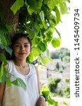 girl posing with genuine smile  ... | Shutterstock . vector #1145409734