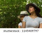 two asian girls  happy  posing... | Shutterstock . vector #1145409797