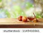 honey and apples on wooden... | Shutterstock . vector #1145410361